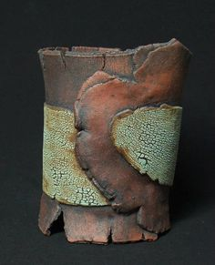By Ankhworks Pottery.  Amazing, I thought this was a wooden cup at first glance.