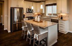 Transitional Kitchen with Pendant Light, Hardwood floors, L-shaped, Flat panel cabinets, Golden Riviera Granite Countertop