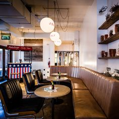 A major feature of the interior is now wood, whether it be in the form of thick chunks perched atop the delicate-looking legs of the bar stools, or more the more refined furniture awaiting those who prefer to take in a bit of street life by the windows...