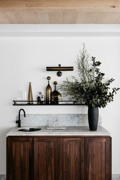 wet bar design - modern & sleek - love the white marble top, dark wood cabinets, and apothecary bottles/dark finishes - design | interiors - inspiration - idea - ideas - decor - interior design - decoration - photography