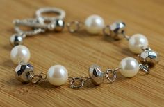 A personal favorite from my Etsy shop https://www.etsy.com/listing/291657777/pearl-silver-bead-bracelet