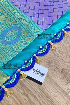 Customised Saree Kuchu & Pallu designs handcrafted to complement your precious silk sarees for celebrating your once in a life time events. Krishne's designer tassel kuchus are our premium offering that are crafted using a combination of handcraft techniques like Aari, Crochet, Tatting, Hand Embroidery, Maggam, Zardozi etc and are in the price range of ₹ 500 ~ 6500. Click www.krishnetassels.com to see all the kuchu types, price range & whatsapp 9916253832 to place your order.. Saree Tassels Designs, Saree Kuchu Designs, Wedding Silk Saree, Graffiti Wallpaper, Saree Border, Signature Design, Silk Sarees, Hand Embroidery, Tatting