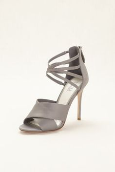 Fabulously strappy, these gorgeous satin high heels are perfect for dressing up any ensemble!  Truly Zac Posen single-soled satin high heel sandals feature a double crisscross ankle strap and open toe.  Heel Height - Approximately 4 inches.  Available in Ivory and Mercury.  Fully lined. Back zipper. Imported.