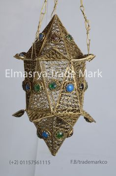Egyptian jeweled Brass Hanging Lantern #CH-113  The weight is 0.78 KG The height is 30cm without chain and with chain is 50cm & 20cm width approximately. The Lantern Handmade in Egypt with100% Brass. it can be used in the dining rooms, entryways, or empty corners. it cast a magical and exotic effect during the night and exude elegance and beauty during the day. Many hours of work through different stages were dedicated to handicraft this piece of art, it will add a great value to your place.