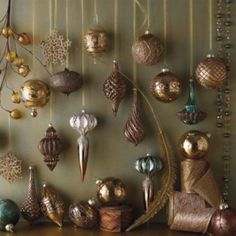 love the darker ornaments and the little bit of teal to set off the copper and