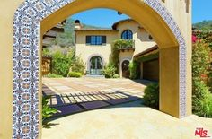 Lauren and her guests will enter the one-acre property through this beautiful tiled archway.