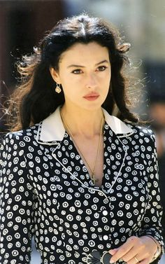 Monica Bellucci, in Maurizio Millenotti, costume designer  for the movie Malena.