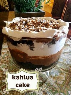 kahlua cake  Any box mix choco cake will do. When it's cool poke holes with a fork all over it and pour 1/3C (or more) Kahlua on top, let set 3hrs to overnight. cut into 1 inch cubes.     deep bowl   layer of cake  layer of chocolate mousse   layer cool whip  repeat.. sprinkle crushed candy bars on top (5 or 6 Heath bars)