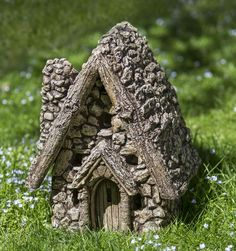 No Instructions, BUT this site has lots of links to beautiful Gnome/Fairy Houses. Gnome Sweet Home from Campania International. This site offers many items to include to your Fairy/Gnome Garden. Stone Garden Statues, Garden Stones, Garden Fountains, Fairy Garden Houses, Gnome Garden, Large Fairy Garden, Fairy House Crafts, Garden Bed, Miniature Houses