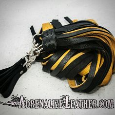 Custom ordered black and yellow bullhide finger flogger set. Order yours at www.adrenalizeleather.com #kink #leather #bondage #fetish #gear #toys #sale #bdsm #sex