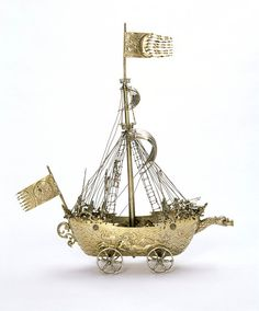 Place of origin: Nuremberg, Germany (made) Date: 1609-1629; Artist/Maker: Esaias zur Linden; Materials and Techniques: silver, parcel-gilt, chased, cast, engraved, embossed. The wheels of this nef might indicate that it was rolled from guest to guest at the high table. The spout at the bow suggests it could also be used as a ewer.