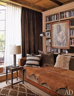 The daybed in the study is clad in leather and silk velvet, both by Ralph Lauren Home.