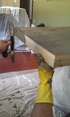 Spreading concrete on the sides Love this! The look of concrete without the weight or all the work! Coffee and side table in family room! LOVE!