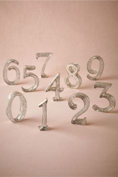 Mercury Glass Table Numbers from BHLDN: these go perfect with the flowers!
