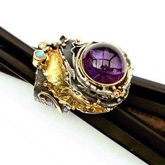 Artist: Eve  Llyndorah: Deva Ring, In sterling silver and 18k yellow gold, with amethyst cabochon, blue moonstone, and champagne diamonds (2.5mm). Stones by Ray Lipovsky.