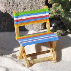 Classic retro stripes, in beach ball colors, give the Striped Beach Chair a coastal vibe. This chair is a fairy garden favorite, because Mermaids need a comfortable place to sit after a long day of deep sea diving. The mini chair is made of durable resin and is underwater safe featuring all-weather paint. Part of the Merriment collection, the Striped Beach Chair miniature garden accessory is designed to look like a vintage wooden fold-up chair.  Create an underwater seating arrangement by…