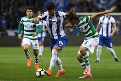 Porto forward Goncalo Paciencia from Portugal with Sporting CP defender Fabio Coentrao from Portugal in action during the Primeira Liga match between...