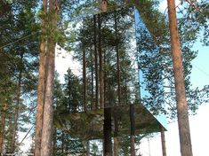 Now you see it... The spectacular Mirrorcube treehouse was designed by Swedish architects Tham & Videgård while the ultra-stylish interior was kitted out with furniture by Alvar Aalto