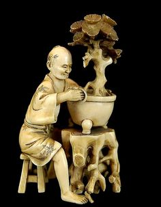 """Japanese Carved Ivory Bonsai Man.  Description: Japanese carved ivory figure depicting a man trimming a bonsai tree, having evidence of an old repair to the hand holding the pot (see photos: hand was separated from body still attached to pot) and a loss of the trimming scissors (see photos). Measures approximately 4"""" tall."""