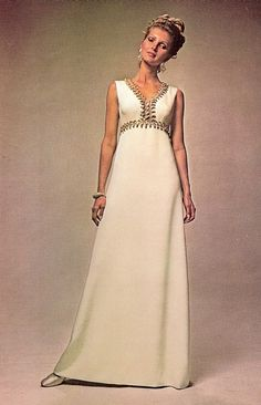 """Oleg Cassini    Model Pat McGuire is wearing a creation by Oleg Cassini.    """"This dress was first created exclusively for Jackie Kennedy, with which she was the Annual Ball of American Vogue in 1968""""."""