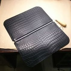 In the making of #clutch bag. Stitch up the zipper. Can't wait to stitch up the rest and see the final goods. :) #Shiang #Taiwan #crocodileskin #handstitched #handmade #craftsmanship #Hermes #gorgeous #clutchbag #goyard #mensfashion #menswear #style #luxury #dapper #womenswear #beautiful #crocbags #exotic #madetoorder #MTO #bespoke #black #zipper #ririzipper #instagood #gift #love