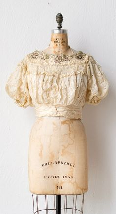 antique silk lace blouse with puffed sleeves and metallic flowers