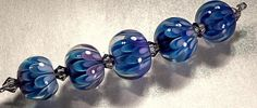 How to Make the Implosion/Petal Beads - Lampwork Etc. :: xLaurieClarkex~ OMG! A tutorial! I may be able to do these someday!!