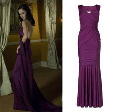 Bond girl Vesper Lynd in Casino Royale, 2006 showed why purple reigns. Get the look with the Leila Dress.