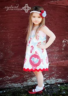 adorable little girl, outfit, and headband! Love the pose too :-)