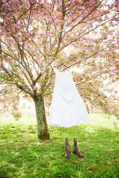 We're obsessed with this pink tree in bloom, the wedding gown blowing in the breeze and the cute cowboy boots underneath. http://my.gactv.com/great-american-weddings/boots/sgallery.esi?soc=pinterest