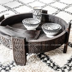 Black & white ethnic vibes with Beni Ourain rugs - handmade ceramic and Moroccan Chakki table www.shop.zocohome.com