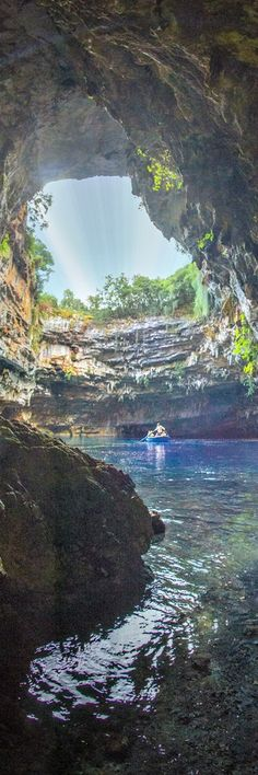 7.Melissani Cave In Greek mythology, Melissani was the Cave of the Nymphs. It features a lake surrounded with trees and forest, and is located east of the mountains of Evmorfia and Agia Dynati. Tourism is common. The lake's bottom is covered with stones. Plants grow at the opening of the cave. The color of the …