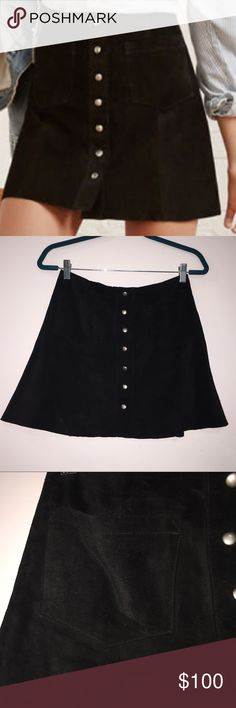 Reformation Tucson Skirt Black Suede This skirt is the absolute best thing in my closet. It's a black suede A-line mini skirt with two pockets and button front closure. I've given this skirt a lot of love and would keep it forever if I thought I'd ever be a size 4 again 😭. She's in great condition, but definitely used. There is a scuff on the top of the left pocket (shown in photo). It's tiny so you can't really see it but will provide more closeup photos if needed! Reformation Skirts Mini