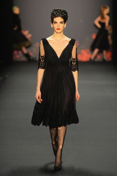 Could do without the torn stockings but the black lace dress is gorgeous. Lena Hoschek Fall 2013