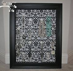 Jewelry hanger...peg board covered with fabric, then cut the holes in the fabric and put crystal pull knobs though the peg board holes and Frame.