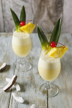 "Bring the tropics into your home with this Sassy Pina Colada. This ""adult coconut water"" has hints of cubed fresh pineapple & rum. It's the perfect way to add a little fun to your Thanksgiving menu! Pina Colada, Classic Cocktails, Fun Cocktails, Cocktail Recipes, Finger Desserts, Finger Foods, Yummy Drinks, Healthy Drinks, Limoncello"