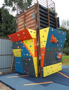 Measuring 10 ft wide x 10 ft high, these two bouldering walls were designed and built for FunScapes, an amusement part in Nairobi, Kenya. We built them against a vertically stacked shipping container. There is also a taller climbing wall on adjacent side of the shipping container.  #FeetOffGround #ClimbingWall #BoulderingWall #RockClimbing #ShippingContainer #ShippingContainerConstructions #RepurposedShippingContainer Climbing Wall, Rock Climbing, Children's Playground Equipment, Bouldering Wall, Outdoor Fitness Equipment, Ropes Course, Repurposed, Building, Food Court