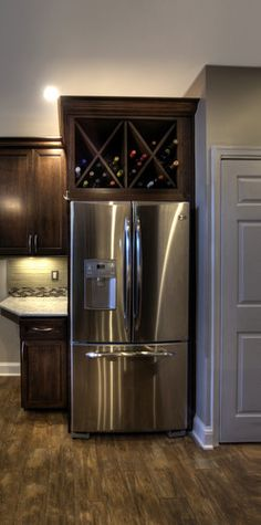 Convert your over-the-fridge cabinets into wine storage. Great idea for those hard-to-reach cabinets!