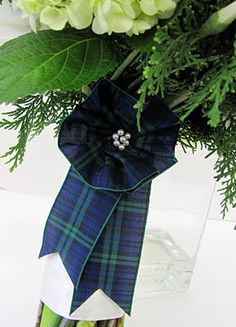 Tartan/plaid bow on the bridal bouquet for a Scottish wedding.