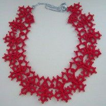 Elegant necklace would set off any business or dress attire with an amazing focal point of hand tatted lace.  This unique piece of jewelry is has two parts. The tatted part measure approximately 12 inches around the neck, It is extended to 18 inches by adding a silver chain and lobster clasp. ...