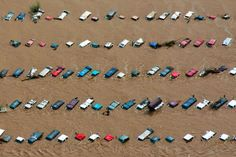 """""""Vehicles submerged in flood waters along the South Platte River near Greeley, Colo., last September. """"Rain comes in heavier downpours,"""" according to the National Climate Assessment, released on Tuesday. Credit John Wark/Reuters"""""""