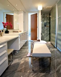 this powder room is a lesson in calm, clean design—with a sink basin and countertop formed from a single piece of custom concrete, plus a wall-hung toilet that keeps floor space open. #bathroom #design #homedecor