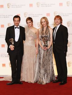 2011: (L-R) David Heyman, Emma Watson, J.K. Rowling and Rupert Grint pose in the press room after the Harry Potter film series was awarded Outstanding British Contribution to Cinema during the 2011 Orange British Academy Film Awards at The Royal Opera House on February 13, 2011 in London, England. [Source: Chris Jackson/Getty Images Europe]