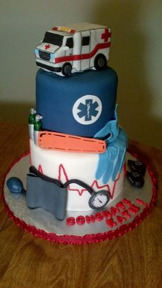 Cake for an EMT graduate with some tools of the trade, the top layer was red velvet with chocolate ganache filling, bottom layer was lemon cake w lemon butter cream and raspberry filling, ambulance was RCT Cupcakes, Cupcake Cakes, Ambulance Cake, Medical Cake, Chocolate Ganache Filling, Raspberry Filling, Fancy Cakes, Creative Cakes, Cakes And More