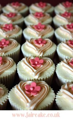 Hearts and pink daisies on cupcakes. #Celebritystyleweddings.com @Jason Jones Style Weddings
