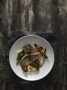 #Steelite #Monaco shown her presenting a stunning #SeaBass dish. The #WhitePorcelain showcased on the old rustic wood creates an eye-catching tabletop display.
