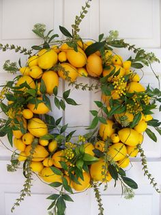 "citrus wreath this a DYI that I think is fabulous for spring time because of the color for a door, or placed on a shudder, depends on your living space, if I were to to it inside I might try to make a different ""form"" like a heart using the wire, or perhaps two straight forms with an option to hold a candle on the bottom and flank a mirror with them."