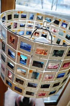 Photo slides made into a lamp shade, all from a vintage collection. Slides of China with the great wall, Buddhas, Hong Kong etc. 15 across by 10, on