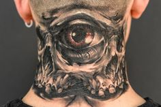 Chronic Ink Tattoo - Toronto Tattoo Double skull and eye tattoo done by guest artist Edgar.