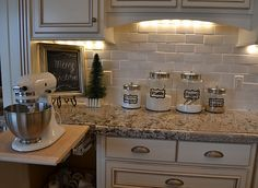 lifted shelf for the kitchen aid...the kitchen aid is bolted to the shelf and then the shelf just comes up!!! amazing! and it has an outlet so it stays plugged in all the time....I WANT THIS!!!!!